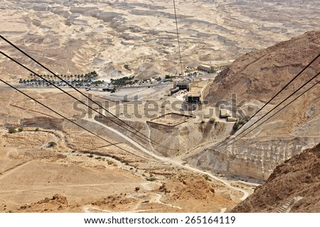 A view from Masada's cable car, from the top of the ancient fortress to the museum and welcome center. - stock photo