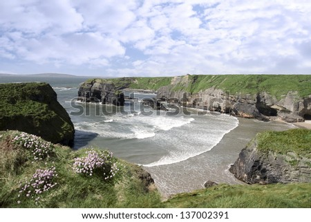 a view from the cliffs in Ballybunion county Kerry Ireland of the Virgin rock and coast - stock photo