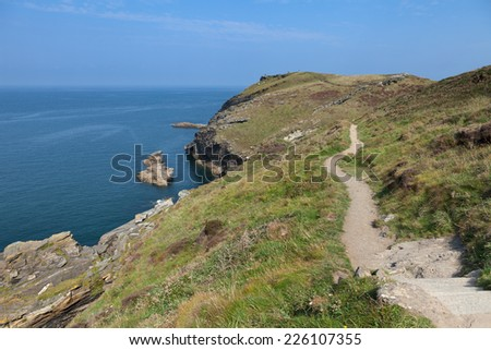 A view from the South West Coast Path on a sunny afternoon near Tintagel in Cornwall, England. - stock photo