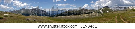 A view from the top of Independence Pass in the Rocky Mountains of Colorado on the continental divide with hikers. - stock photo