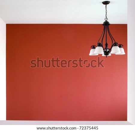 A view into a room with one red wall. - stock photo
