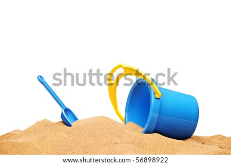 A view of a basket and scoop at the beach isolated on white background - stock photo