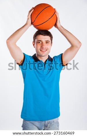 A view of a basketball player shooting basketball isolated on white background - stock photo