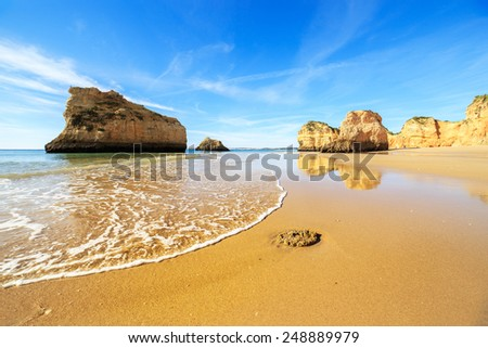 A view of a beach in warm sunset light, Portugal - stock photo