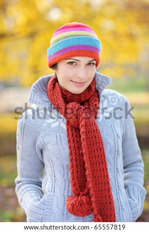A view of a beautiful young woman in autumn park - stock photo