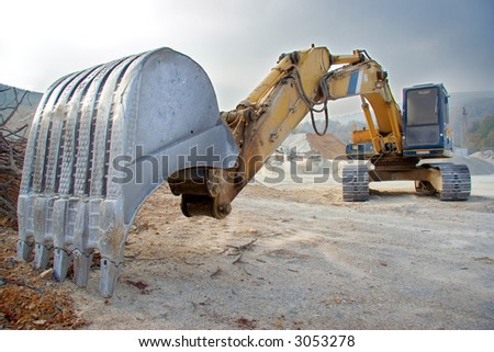 A view of a big bulldozer at construction site - stock photo
