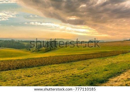 A View of a big farmer's field with colorful skies