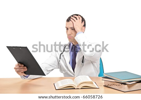A view of a doctor banging his head realizing a mistake isolated on white background - stock photo