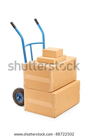 A view of a hand truck with many boxes on it isolated on white background