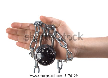 A view of a hand, wrapped in a steel chain and securely locked with a combination lock.  Isolated on white background.