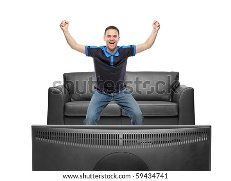 A view of a happy sport fan watching TV against white background