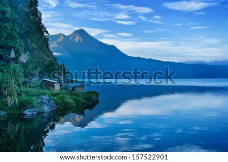 A view of a lake and mountain in Bali Indonesia - stock photo