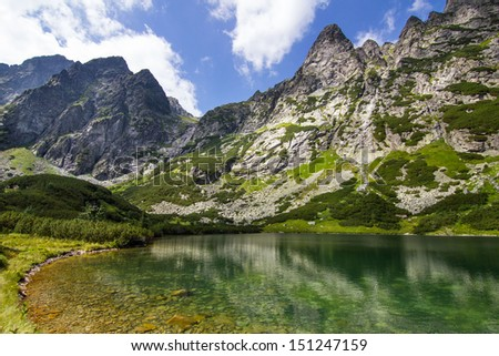 A view of a lake in high Tatra mountains in a morning sun, Slovakia