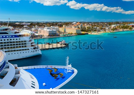 A view of a large cruise ship docked along the waterfront of Nassau, Bahamas. - stock photo