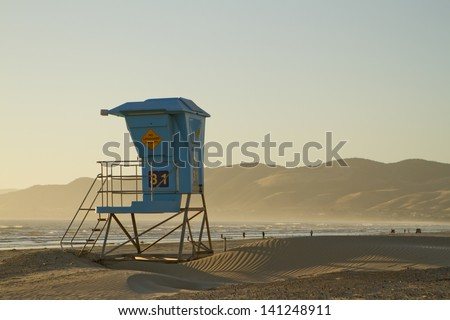 A view of a lifeguard stand in Pismo Beach, California. - stock photo