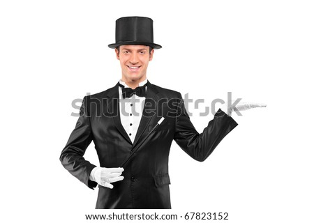 A view of a magician wearing top hat with raised left hand isolated on white background - stock photo