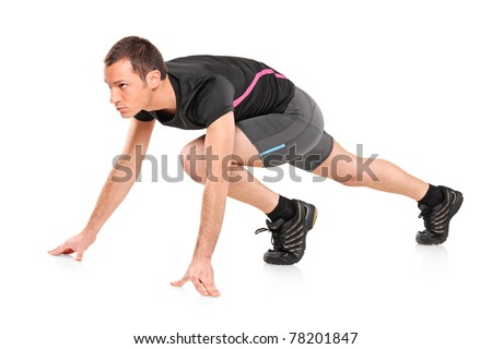 A view of a male athlete ready to run isolated on white background