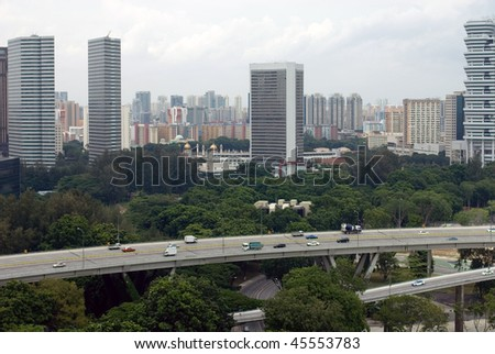 A view of a modern skyscrapers and a busy freeway in Singapore