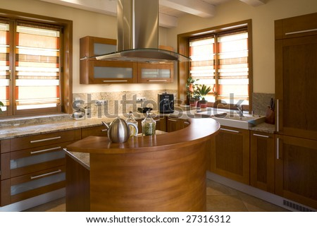 A view of a new, modern, well furnished home kitchen. - stock photo