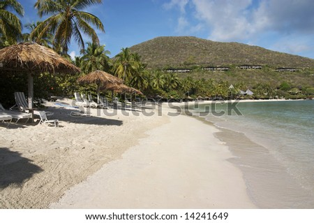 A view of a peaceful island beach resort. - stock photo