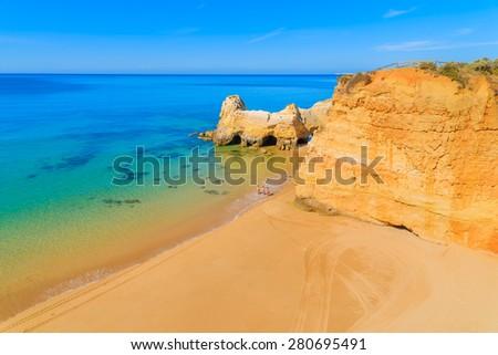 A view of a Praia da Rocha beach with golden cliff rocks in Portimao town, Algarve region, Portugal - stock photo
