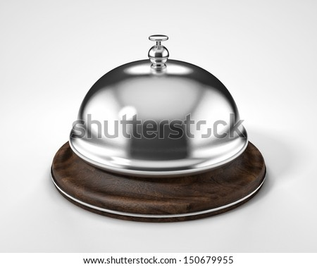 A view of a reception hotel bell ring with wooden pedestal isolated on white background