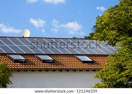 A view of a roof with solar battery - stock photo