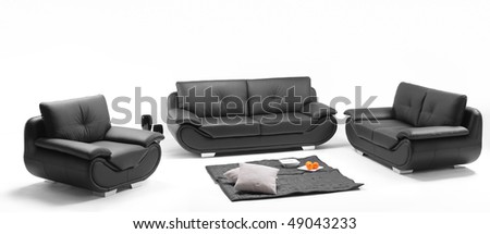 A view of a room with black leather sofa - stock photo