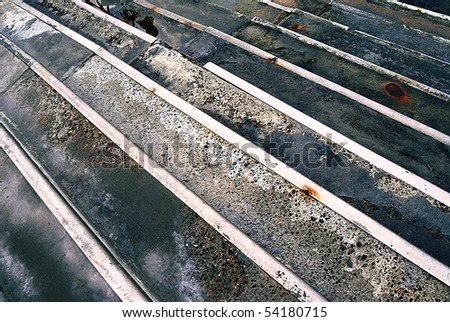 A view of a rusty concrete steps leading to the riverside