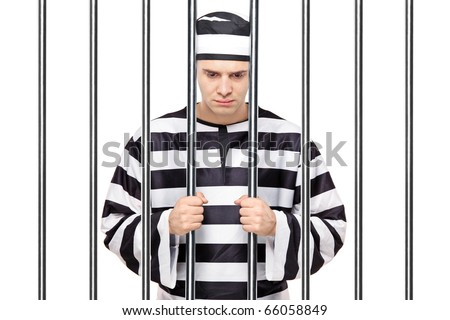 A view of a sad prisoner in jail holding bars isolated on white background