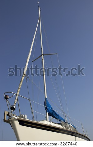 A view of a sailing boat looking up at the mast