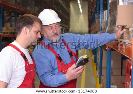 A view of a senior engineer training a newly hired employee. - stock photo