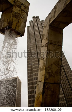 a view of a skyscraper from the Vaillancourt Fountain - stock photo
