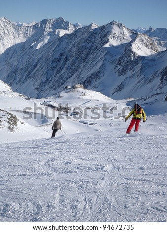 A view of a snow covered mountain with skiers a ski resort in Neustift, Austria. Taken in vertical format. - stock photo