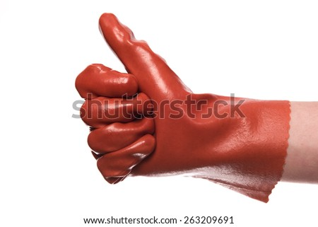A view of a thumb up with a glove isolated on a white background - stock photo