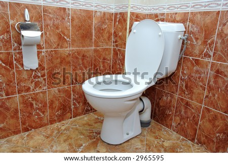 A view of a toilet in a hotel room - stock photo