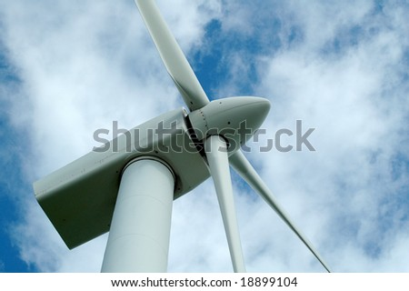 A view of a wind turbine from below