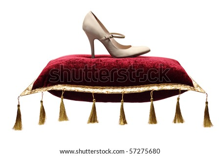 A view of a woman's shoe on a pillow isolated on white - stock photo