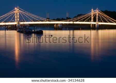 A view of Albert Bridge at dusk - stock photo