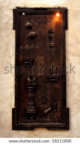 a view of an authentic arabian wooden door - stock photo