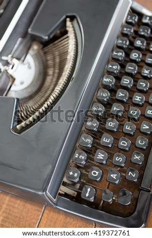 A view of an old fashioned typewiter on a desk