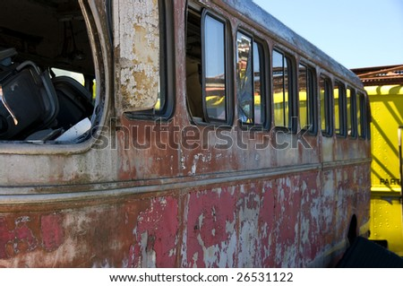 A view of an wrecked bus in a junkyard - stock photo