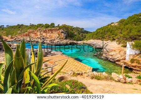 A view of beach and traditional houses in a village, Cala S'Almunia, Majorca island, Spain - stock photo
