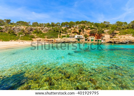 A view of beach with azure sea water, Cala Llombards, Majorca island, Spain - stock photo