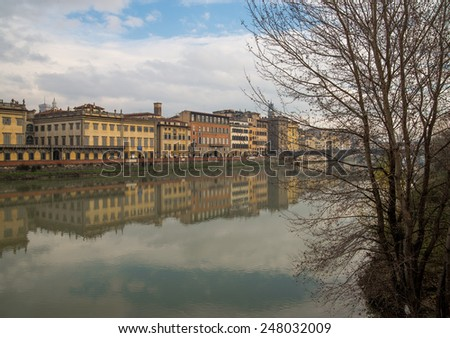 A view of beautiful palaces along Arno river of the historic center of Florence - stock photo