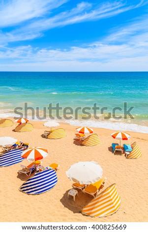 A view of beautiful sandy beach in Armacao de Pera seaside town, Algarve region, Portugal - stock photo