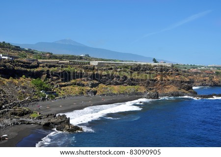 A view of Bollullo Beach with Teide volcano at the bottom in Tenerife, Canary Islands, Spain