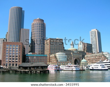 A view of Boston Harbor including Rowes Wharf. - stock photo