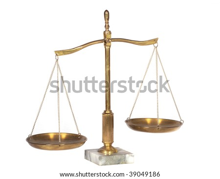 A view of brass scales on marble base - stock photo