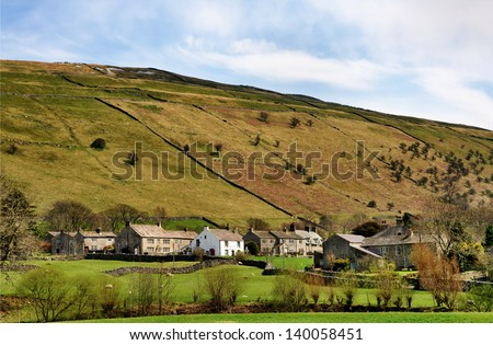 A  view of Buckden, a picturesque village in the rolling countryside of Wharfedale in the Yorkshire Dales, England, on a sunny spring day. - stock photo